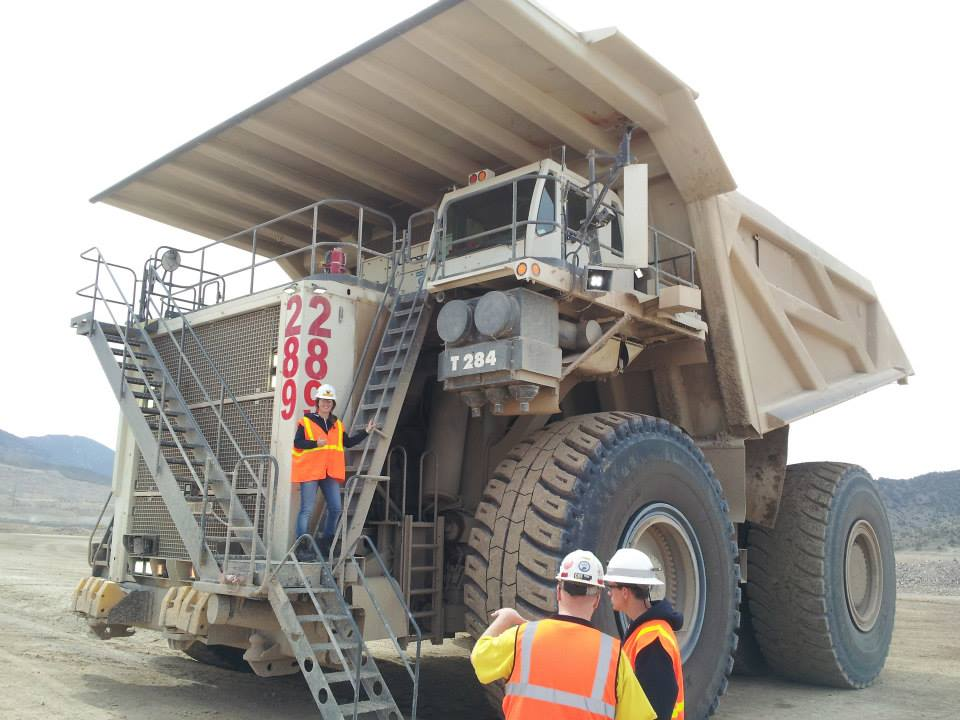 Izzy Dickinson mining engineer with mining truck
